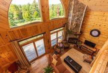 29 Snowshoe Ridge, Warrensburg NY / Explore this rare opportunity to enjoy the modern amenities of this custom-built Adirondack log home with an authentic feel of a Great Camp in close proximity to Gore Mountain, Lake George the Northway. Once inside the large open floor plan with approximately 4,000 sqft of gorgeous living space, showcases a stunning floor to ceiling stone fireplace, wood floors and screened porch. The well-sized kitchen with stainless steel appliances is open to the dining and great room for entertaining.