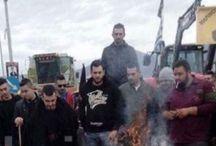 ΦΩΤΟ από την διαμαρτυρία κτηνοτρόφων στον Τύρναβο - Έχυσαν γάλα και έβαλαν φωτιά