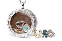 Four Keeps / Sterling Silver and genuine stone interchangeable lockets and charms with genuine mother of pearl insert...Choose your locket and add charms to make that special moment last forever...Four Keeps at 33 & Pioneers!