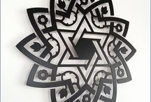 Judaica Home decor Magen David / Jewish decoration Magen David -  40 cm (15.75 inches), metal laser cut - Black matt powder coating paint http://www.delorentis.eu/magen-david-decoration.html  Wall ornament Magen David.  Features: diameter 15.75 inches, steel 2 mm laser cut, colour Black mat - painting oven baked powder coating.  For further information feel free to contact info@tolonensis.com