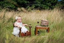 Smash the cake! / A very cute baby girl's 1st birthday involved a cake smash in a Cornish field!