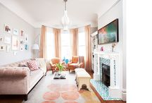 Chic Victorian / We completed this vibrant home in San Francisco for a young tech exec. Bold graphics and juicy colors are a backdrop for custom and vintage pieces, creating a space with energy and visual pop. The living room is home to a custom, blush-velvet Chesterfield sofa and pale-pink silk drapes, the den features a custom velvet sofa set against a wall of graphic orange and grey wallpaper, and the bedroom is a serene space in ethereal pink and lavender.