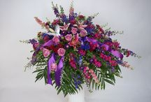 Sympathy Arrangements / Sympathy Arrangements by Gillespie Florists! Our large traditional bouquets create a stunning statement of comfort and a lasting impression at the service. We can personalize your arrangement with lovely gold script on the ribbon or perhaps a symbolic keepsake angel for your loved one. With many styles, sizes and options available, we at Gillespie Florist's are dedicated to designing a tribute that uniquely represents you.
