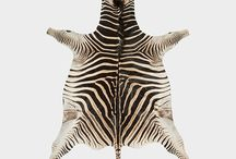 EXOTIC GAME SKINS: ZEBRA / (EQUUS BURCHELLI) We stock a wide range of superbly tanned Zebra Skins at competitive prices. They are all certified & fully exportable. Felting an optional extra.  GRADING  Our zebra skins are graded according to: size, beauty of mane and tail, richness in colour as well as the amount of natural markings such as scars and scratches.