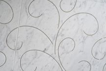 Luxury Surfaces / We are pleased to introduce you to our new line of Luxury surfaces. The Diamond Collection features curving lines of Swarovski crystal on beautiful Italian white marble. Our Luminous Collections offers stunning surfaces of natural stone accented with brushed silver, copper or gold foil. I can't wait to see how our clients will use it. Visit our website for more info…. www.marbleoftheworld.com