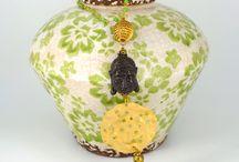 Jewels made by Amalia// Buddha's Planet necklace / Buddha's Planet necklace. Handmade jewel with resin Buddha, glass bead rosario and silk tassel