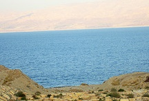 Dead Sea Area, Israel / The Dead Sea, also called the Salt Sea, is a salt lake bordering Jordan to the east and Israel and the Palestinian Authority to the west. Its surface and shores are 423 meters (1,388 ft) below sea level, Earth's lowest elevation on land. The Dead Sea is 377 m (1,237 ft) deep, the deepest hypersaline lake in the world. With 33.7% salinity, it is also one of the world's saltiest bodies of water. It is 8.6 times saltier than the ocean. ~Wikipedia