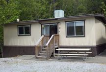 Our 2 Bedroom Cabins / Our 2 bedroom Cabins can accommodate up to 8 guests.  Fully functional kitchen with all housewares, microwave, oven, refrigerator, toaster, coffeepot.