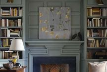 Bookshelves next to fire place