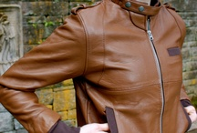 """THE RUBLY / The Rubly is a style often referred to as """"Members Only"""". Well, you don't need to know the secret handshake to wear the Rubly. The Rubly features a double snap collar, shoulder snap detail and ribbing lined pockets. All of our jackets are one-of-a-kind. The jacket you see pictured is the jacket you will receive."""