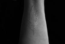 tattoos & piercings / by Alethea Davenport