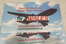 Fly 2 Wales mechandise / At Fly 2 Wales we have used many forms of advertising platforms and merchandise, here are but a few, if you have a Welsh overseas group or community we will gladly post some to you.