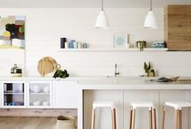 white kitchen with timber flooring