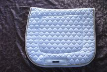 Dressage Saddle Blankets / 4 styles: Large, Standard, Shaped and Swallow Tail. Comes as plain or piped or with fluffies. Huge colour range. We can custom make to your requirements. Go to www.bjmerino.co.nz for more information. Phone +6427 276 9158 bjmerinonz@hotmail.co.nz