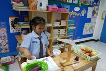 """P1 Math students enjoying learning about weight and scales"