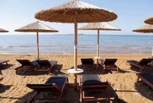 Xi Beach | Kefalonia | Costa Rossa | Sunbeds | Red Sand / Xi beach is located on the peninsula of Paliki, Kefalonia, 7km from the town of Lixouri. Costa Rossa's sunbeds on the beach.