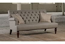 Traditional button back sofas.