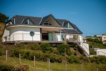 The Beach House, Mawgan Porth - Cornwall / Nestled into the private Headland of Mawgan Porth, The Beach House is an exclusive, luxury holiday home that enjoys unbeatable views of the ocean and Cornish coastline, and close proximity to Mawgan Porth beach.