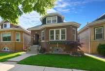 SOLD - 3018 Newcastle Avenue - Chicago, IL. 60634 / $279,900 - Luxurious living in this brick Bungalow home on a tree-lined street across the street from Bell Park!  Custom crafted & thoughtfully upgraded, this home is completely refreshed.  Sleek & stylish upgraded gourmet kitchen with every amenity for the avid chef.  Kitchen leads to a sun-drenched porch perfect for relaxation. Enjoy a finished basement with bath, a huge garage & ample sized yard. Too many amenities to list!
