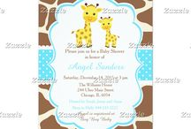 Giraffe Blue Polka Dots / This design features cute giraffes, mother and baby, with a giraffe print background and a blue polka dot ribbon.