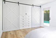 master bedroom closet with barn doors