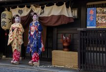 Zuiki Matsuri in the Kamishichiken Geisha District of Kyoto. / Today, I attended the Zuiki Matsuri (ずいき祭  瑞饋祭) in the Kamishichiken (上七軒) Geisha District of Kitano Tenman-gū (北野天満宮) in Kyoto. Here are some Maiko from Ochaya Nakazato (お茶屋中里) enjoying the parade. Zuiki Festival is dedicated to the shrine deity which people express gratitude for good harvest of the year. The roof of two mikoshi portable shrines, large and small, are made of taro stem (zuiki).