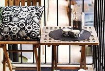 Accessorise Outside / Add a sense of style and personality to your outdoor areas by accessorising with beautiful cushions, rugs, chairs and pots.