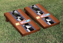 NASCAR Cornhole Boards, Giant Jenga Tumble Tower, Washers and Tailgating Games / Fantastic NASCAR Cornhole Sets featuring your favorite driver, the NASCAR Giant Jenga Tumbling Tower Game, One-hole washers tailgate party game and NASCAR Corn Hole bags and accessories.