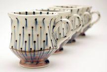 Beginning pottery Mugs!! / by Melinda Shepherd
