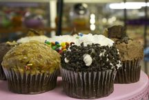 Stuffed Cupcakes! / Our homemade stuffed cupcakes are large muffin sized cupcakes generously stuffed with filling and topped with flavorful icings and toppings to complete the experience. We are also happy to over standard cupcake sized varieties as well. (not all flavors are available in standard size)