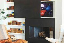 TV hidden above fireplace