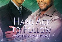 Kimber Vale, Hard Act to Follow / Gay Romance. Book #3 in the Shooting Stars series but a standalone nonetheless. Sweet, sexy and fun. Interracial couple, opposites attract - a sassy and flamboyant arts major with a slightly older, dependable friend and lawyer.