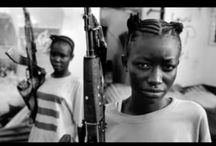 """Child Soldier Fashion / Looking for a fresh, funky, topical summer ensemble for the young ones?  Want to make """"Kony Famous"""" with your children's fashion?  Now your tyke will be ready for anything, whether it's a village you need decimated, a political leader you need deposed, or an enemy you need to humiliate.  PVSP Vintage is proud to be the first-ever worldwide black-owned child soldier fashion label.  Contact us now to get a head start on purchasing our Summer 2012 Collection!!"""