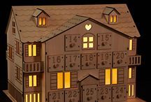 Wooden Advent Calendar House / A wooden advent calendar house looks beautiful in your home and is a great way to count down the days until Christmas. Plus, they just do so much to evoke that holiday spirit.