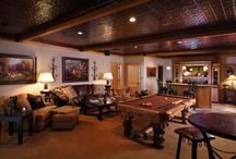 Log Home Basements / Some interesting ways to finish out a basement in a log home