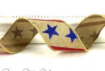 CottageCO: Americana / USA patriotic themed ribbons and craft embellishments. American flag ribbons; stars and stripes; red, white and blue trims, jingle bells and berry sprays. Ribbons and trims that fit a rustic Americana theme.