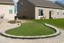 Putting Greens / These are people's homes who have a putting green in their own backyard because they love golfing!