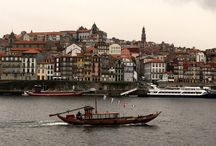 Porto / Porto is a coastal city in northwest Portugal known for its stately bridges and Port wine production. In the medieval Ribeira (riverside) district, narrow cobbled streets wind past merchants' houses and cafes. São Francisco church is known for its lavish baroque interior with ornate gilded carvings. The palatial 19th-century Palácio de Bolsa, formerly a stock market, was built to impress potential European investors.