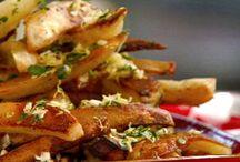 Potato Dishes / A board full of potato dishes.