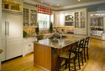 Elegant White Country Kitchen in Milton, GA / Custom Traditional Kitchen with white self-closing cabinets, granite countertops, custom backsplash, and Viking appliances.