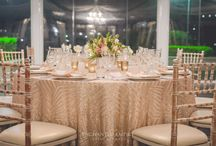 Luxe Geometric Champagne Wedding / Framed by beautiful ivory draping and a cascading crystal chandelier, this wedding had a stunning impact from floor to ceiling. Tables were dressed in geometric champagne sequin tablecloths and were complimented by soft satin napkins and custom designed wedding stationery. Limewash Tiffany chairs added elegance to the styling and drew your eye towards the center of this lavish table to its crisp white florals and elegant pink hues. Youtube: www.youtube.com/watch?v=_mtIU2l6Nqk  Enchanted Empire