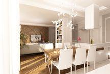 Wystrój wnętrz eleganckiego apartamentu na Mokotowie. / Projekt wnętrz eleganckiego apartamentu na Mokotowie. Salon połączony z kuchnią w klasycznym stylu, z drewnianym detalem i nowoczesną zabudową kuchenną.