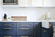 Do You Have the Brass (Hardware)? / Gilded golden handles and knobs have reemgered from adorning 80's pepto and mint-colored bathrooms to defining modern and trendy cabinets.