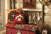 Western Style Interior / Raw, rough hewn woods, inviting fabrics or cozy plaids play up the Western look. Worn leathers mixed with stone hearths or walls and other natural elements. Furniture is usually large scaled and wooden.