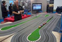 Giant Scalextric / Our newly developed fully digital scalextric system offers many new benefits not previously available in the Giant Scalextric Hire market, enabling us to offer the most technologically advanced Scalextric setup available, racing up to 8 cars on 3 lanes with exciting overtaking manoeuvres.