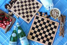 On the Go Chess / Heading on a road trip this summer? Or just love kicking it in the park with a couple classic board games? If traveling light is not top of mind and you'd rather play a full size board game than those miniature magnetic ones, follow our tutorial for how to turn lovely wooden checkers and chess sets into full-size travel games. The trick? VELCRO® Brand Sticky Back White Coins, of course!