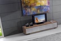 TV Units & Wall Compositions / Today's TV's need contemporary TV units to house them in. Whether the TV sits on top of the contemporary TV unit or above it, there is a wide variety of contemporary TV units to choose from at Gainsville. You may choose from glass, high gloss or chrome and they come in many configurations to suit your room dimensions.