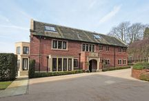 Detached House for sale Alderley Edge, Cheshire SK9 7BN / An exceptional small Estate comprising a 6 bedroom house with leisure suite, 1 bedroom cottage and office block, all nestled in outstanding grounds, with one of the most glorious south-facing views in Cheshire.  £4,950,000