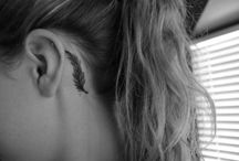 Tattoos and piercings / by Sara Turcotte