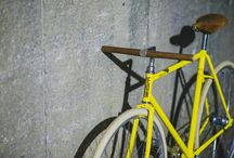 REBORN yellow C / A two speed city bike. This yellow ride was a custom build project hooked with a Sram Automatix rear hub with a coster brake and a flat bar wraped in brown leather stitched with read thread. One small detail is the cork bar ends. The wheels are laced with classic aluminium Remerx rims in 36H, steel spokes and a Shimano front hub. The Gipiemme crank and KMC golden chain makes a cool drive set for this bike. Some cream Schwalbe tires to match the looks.